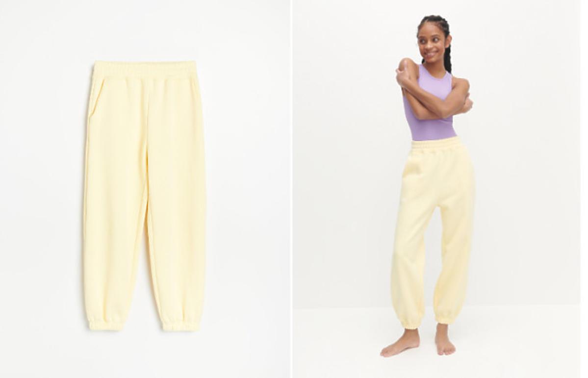 spodnie dresowe - żółte joggersy z Reserved